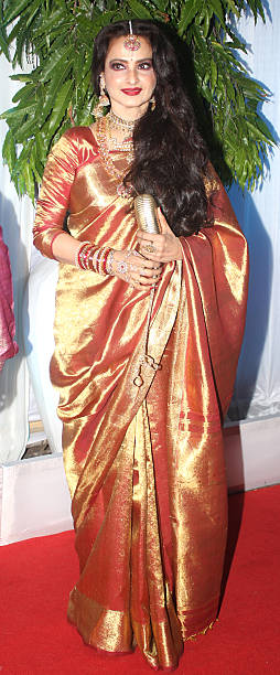 Bollywood actor Rekha arrives at the wedding reception of Esha Deol and Bharat Takhtani in Mumbai on Saturday