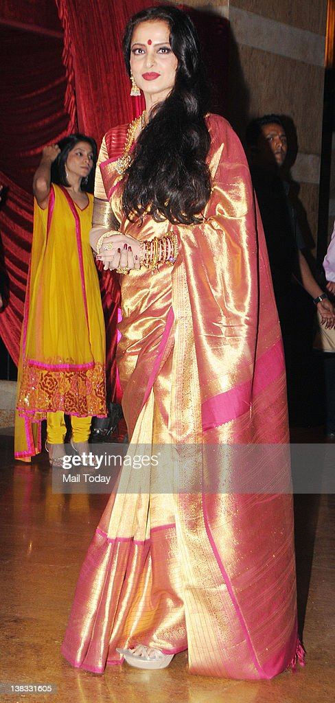 Bollywood actor Rekha attends the wedding reception of actors Ritesh Deshmukh and Genelia D Souza in Mumbai on February 4 2012