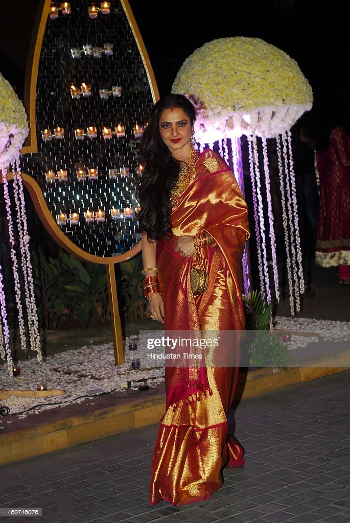 Bollywood actor Rekha during wedding ceremony of Riddhi Malhotra and Tejas Talwalkar on December 15 2014 in Mumbai India Riddhi Malhotra is sister of.