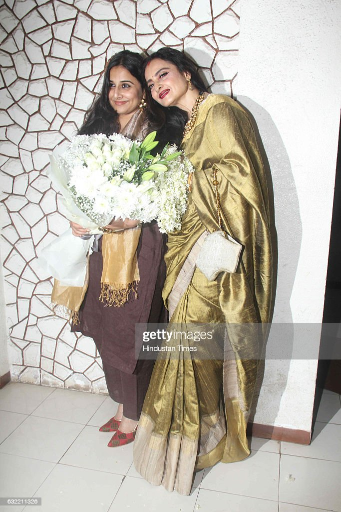Bollywood actor Rekha with Vidya Balan during the birthday party of Javed Akhtar at his residence in Juhu on January 17 2017 in Mumbai India