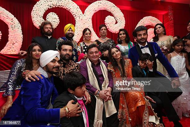 Bollywood actor Rishi Kapoor poses with wedding couple Daler Mehndis daughter Ajit Kaur and Navraj Singh son of singer Hans Raj Hans and their family...