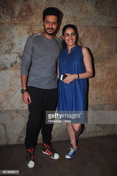 Bollywood actor Riteish Deshmukh with his wife and actor Genelia D'Souza during the screening of film Bobby Jasoos on July 3 2014 in Mumbai India