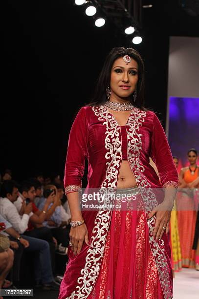 Bollywood actor Rituparna Sengupta walks on the ramp displaying the jewellery collection from Sanskriti Jewels And Jewel Trendz during the India...
