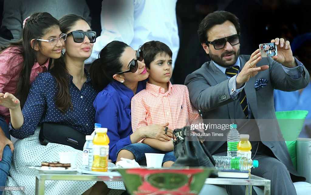Bollywood actor Saif Ali Khan clicking a selfie with his wife Kareena Kapoor sisterinlaw Karisma Kapoor and her children Samiera and Kiaan Raj during.