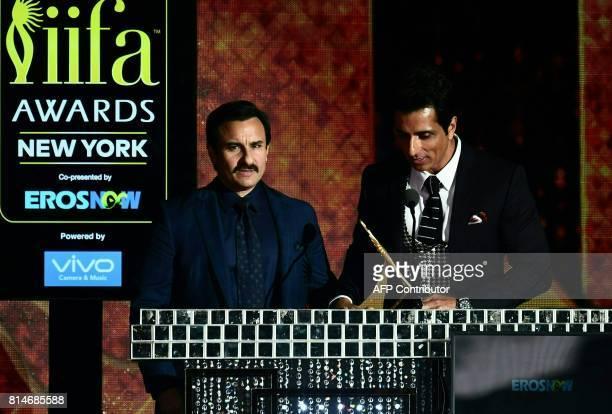 Bollywood Actor Saif Ali Khan speaks on stage as Bollywood actor Sonu Sood looks on during IIFA Rocks July 14 2017 at the MetLife Stadium in East...