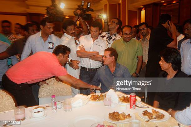 Bollywood actor Salman Khan his brother Sohail Khan and father Salim Khan with Bollywood actor Shahrukh Khan at INC MLAs Baba Siddique's iftaari...