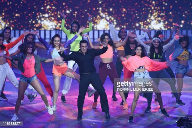 Bollywood actor Salman Khan performs on stage during the 20th International Indian Film Academy Awards at NSCI Dome in Mumbai early on September 19...