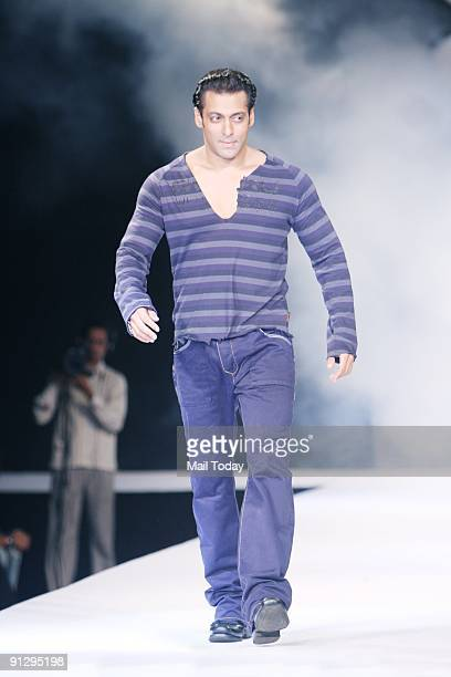 Bollywood actor Salman Khan walks the ramp during a fashion show organised by the Italian fashion brand 'Guru' during its India launch ceremony at a...