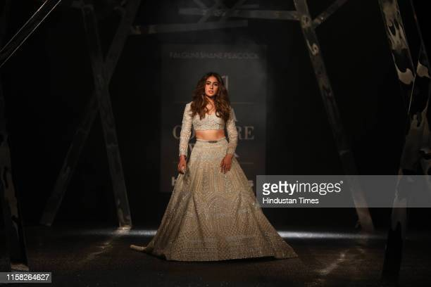 Bollywood actor Sara Ali Khan walks the ramp for designerduo Falguni Shane Peacock at the day five of the 12th edition of the FDCI India Couture Week...