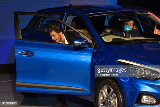 Bollywood actor Shah Rukh Khan along with MD and CEO Hyundai Motors India Ltd Y K Koo launch the Swacch Can a portable bin for all Hundai cars during...