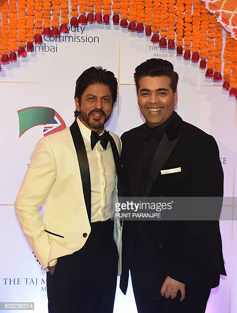 Bollywood actor Shah Rukh Khan and director Karan Johar pose for photographers after arriving for the Charity Gala reception attended by Britain's...