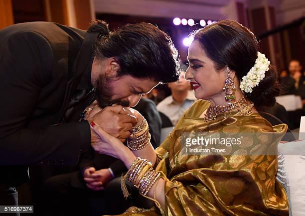 Bollywood actor Shah Rukh Khan kisses hand of veteran actress Rekha during Hindustan Times Most Stylish Awards 2016 at Taj Lands End, Bandra on March...