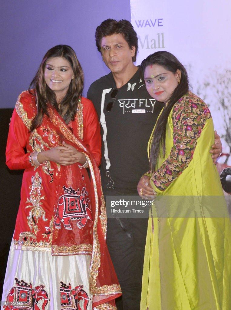 Bollywood actor Shah Rukh Khan posing with Singer Nooran sisters during the promotion of his upcoming movie 'Jab Harry Met Sejal' at village Jhande...