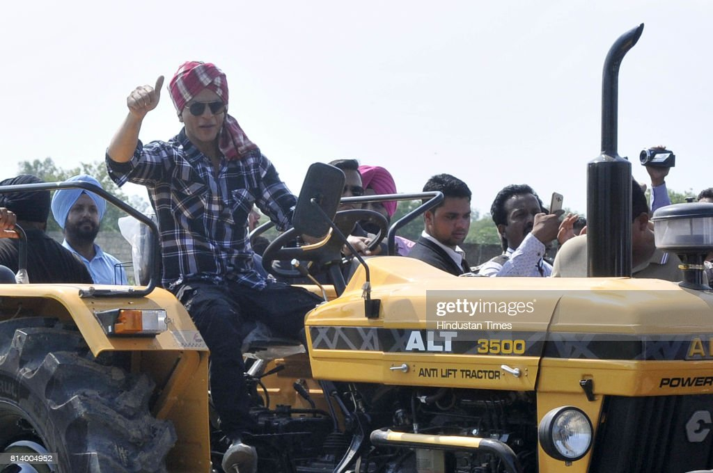 Bollywood actor Shah Rukh Khan riding a tractor during the promotion of his upcoming movie 'Jab Harry Met Sejal' at village Jhande on July 13 2017 in.