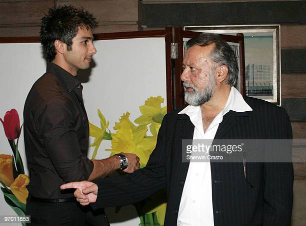 Bollywood actor Shahid Kapoor and his father film producer and actor Pankaj Kapoor arrive to attend the wedding reception for Rashi Agarwal and...