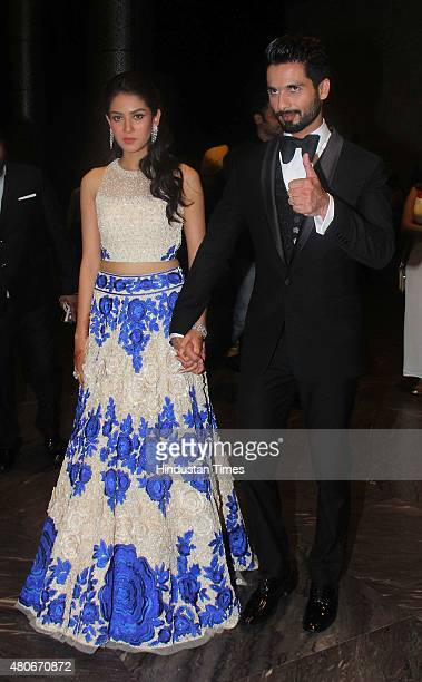 Bollywood actor Shahid Kapoor with his wife Mira Rajput during his wedding reception at Palladium Lower Parel on July 12 2015 in Mumbai India
