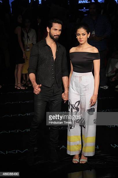 Bollywood actor Shahid Kapoor with his wife Mira Rajput during the Lakme Fashion Week Winter/Festive 2015 on August 29 2015 in Mumbai India
