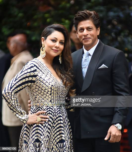 Bollywood actor Shahrukh Khan and his wife Gauri Khan arrive for the preengagement party of India's richest man and Reliance Industries Limited...