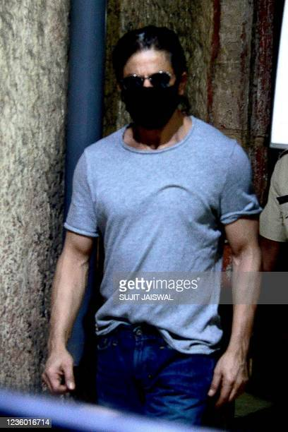 Bollywood actor Shahrukh Khan leaves Arthur road jail in Mumbai on October 21, 2021 after visiting his son Aaryan Khan, who was was arrested earlier...