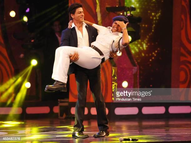 Bollywood actor Shahrukh Khan lifting a Kolkata Policewoman while performing a dance step at Jai Ho the Kolkata Polices annual cultural programme at...