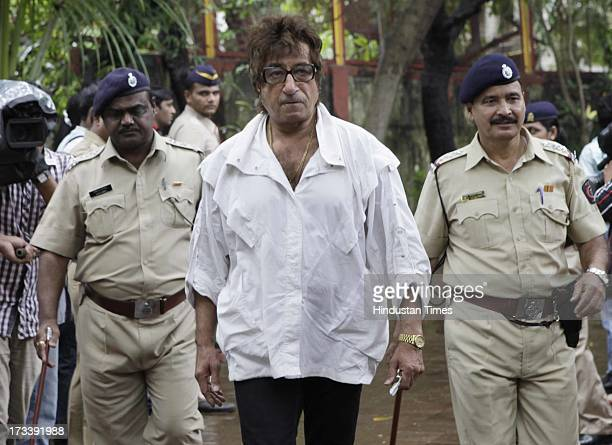 Bollywood actor Shakti Kapoor arrives to pay his last respects to Bollywood actor Pran during the cremation at Shivaji Park Crematorium Dadar on July...