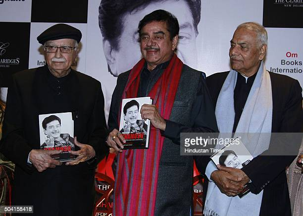 Bollywood actor Shatrughan Sinha and politicians LK Advani and Yashwant Sinha during the launch of his book 'Anything But Khamosh' written by...