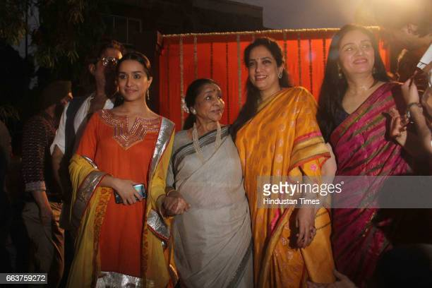 Bollywood actor Shraddha Kapoor Padmini Kolhapure Rashmi Thackeray and singer Asha Bhosale during the opening of Pandit Pandharinath Kolhapure Marg...