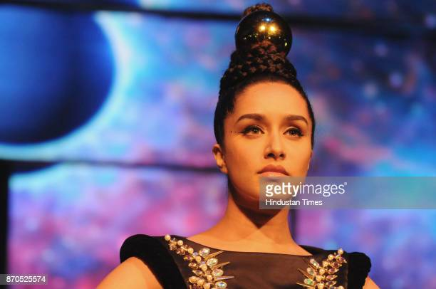 Bollywood actor Shraddha Kapoor walks on the ramp showcasing a creation by designer Manish Arora during the Blenders Pride Fashion Tour at Kingdom of...