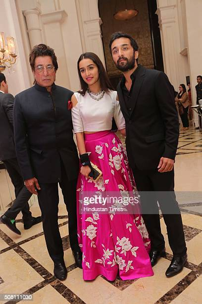 Bollywood actor Shraddha Kapoor with her father and actor Shakti Kapoor and brother Siddhant Kapoor during an engagement party of her best friend...