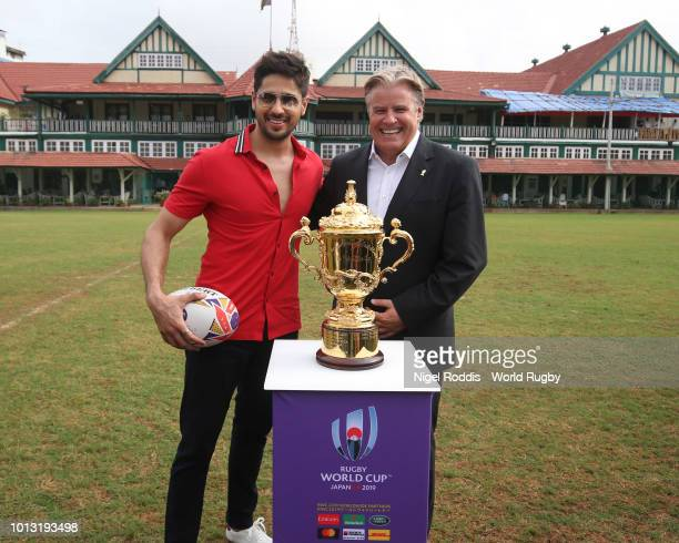 Bollywood actor Siddharth Malhotra and Brett Gosper World Rugby via Getty Images CEO with the Webb Ellis Cup during the Rugby World Cup 2019 Trophy...