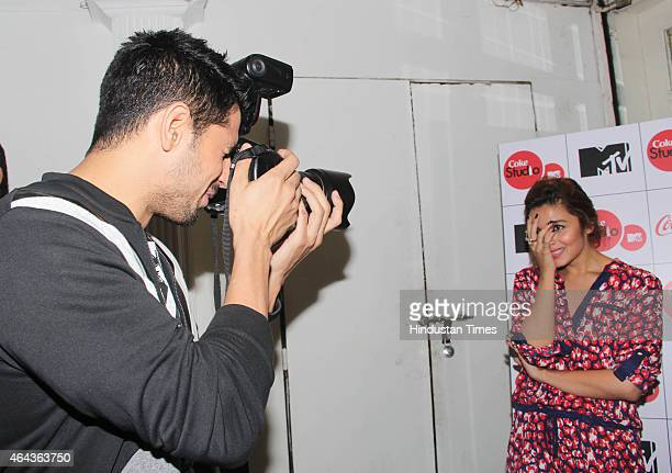 Bollywood actor Sidharth Malhotra tried his hand at photography clicking pictures of Alia Bhatt at Coke studio season 4 press conference at Villa 69...