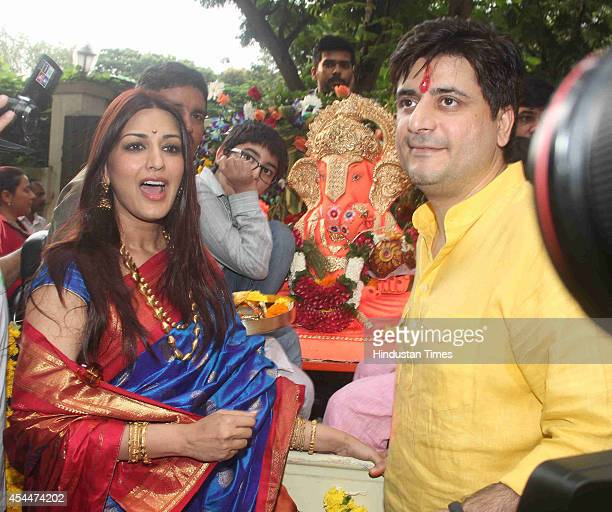 Bollywood actor Sonali Bendre with her husband Goldie Behl at their Ganesh Idol immersion procession on August 30 2014 in Mumbai India
