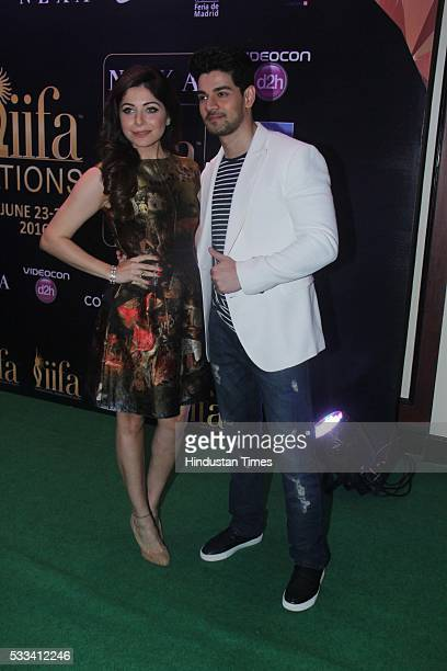 Bollywood actor Sooraj Pancholi with singer Kanika Kapoor during the press conference of 16th International Indian Film Academy Awards at Taj Lands...