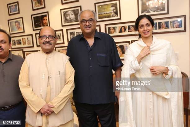 Bollywood actor Sridevi and husband producer Boney Kapoor with politician Amar Singh during the private screening of the movie 'Mom' at politician...