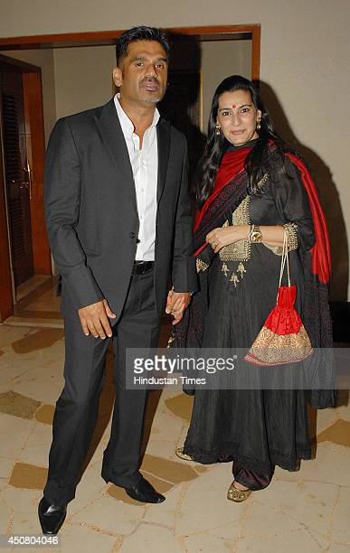 Bollywood actor Suniel Shetty with his wife during a party hosted by Filmmaker Pahlaj Nihalani at Suburban Hotel on June 14 2014 in Mumbai India