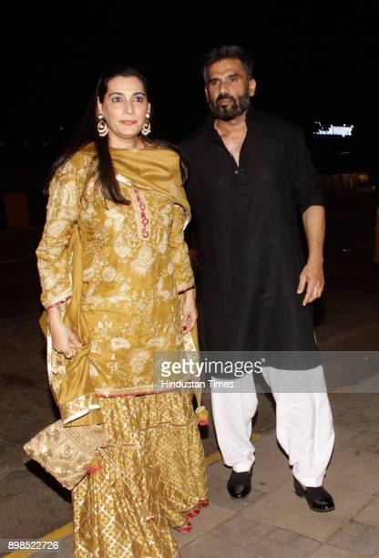 Bollywood actor Suniel Shetty with wife Mana Shetty at wedding reception of Kanchan Ketan Desais daughter on December 23 2017 in Mumbai India
