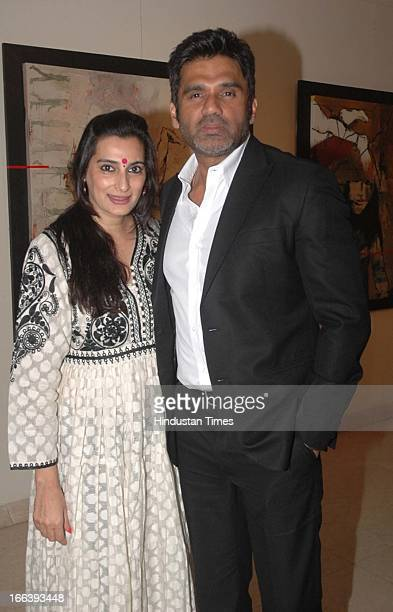 Bollywood actor Sunil Shetty with his wife Mana Shetty during the Jaya Lamba's Art exhibition at Gallery Art Soul Worli on April 10 2013 in Mumbai...