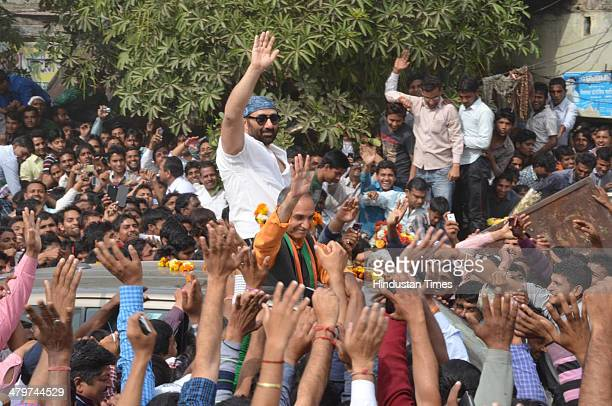 Bollywood actor Sunny Deol campaigns for BJP candidate from Bagpat Lok Sabha constituency Satyapal Singh by road show on March 20 2014 at Baghpat...