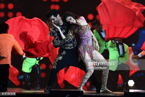 Bollywood actor Sushant Singh Rajput and actress Kriti Sanon perform during IIFA award of the 18th International Indian Film Academy Festival at the...