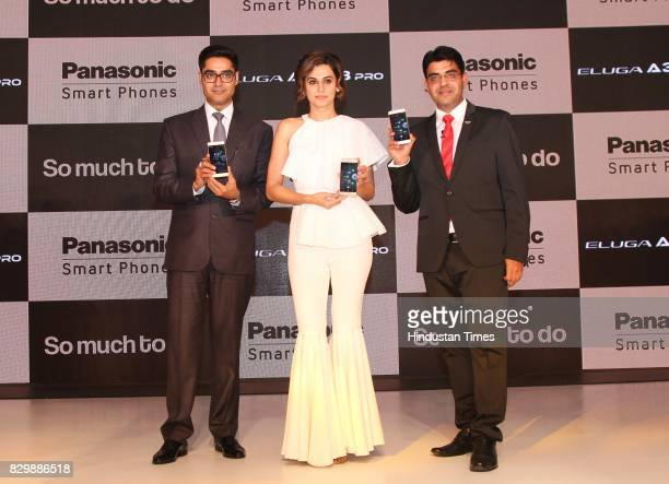 Bollywood actor Taapsee Pannu flanked by President CEO Panasonic India South Asia Manish Sharma and Business Head Mobility Division Panasonic India...