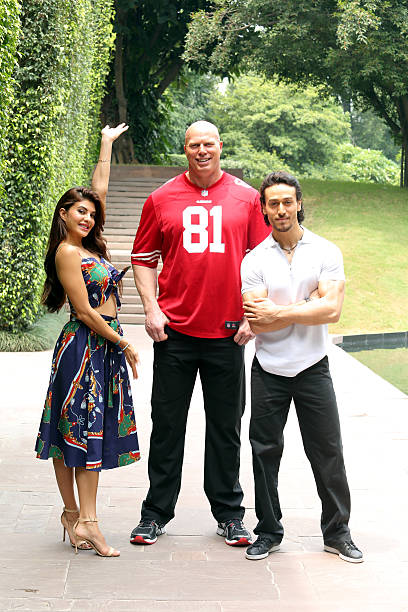 Bollywood actor Tiger Shroff and Jacqueline Fernandez with Australian Professional wrestler and actor Nathan Jones posing for a profile shoot during..