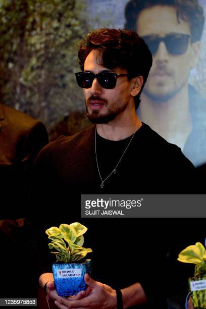 Bollywood actor Tiger Shroff holds plant during the launch of global campaign on urban forestry and climate change, in Mumbai on October 19, 2021.