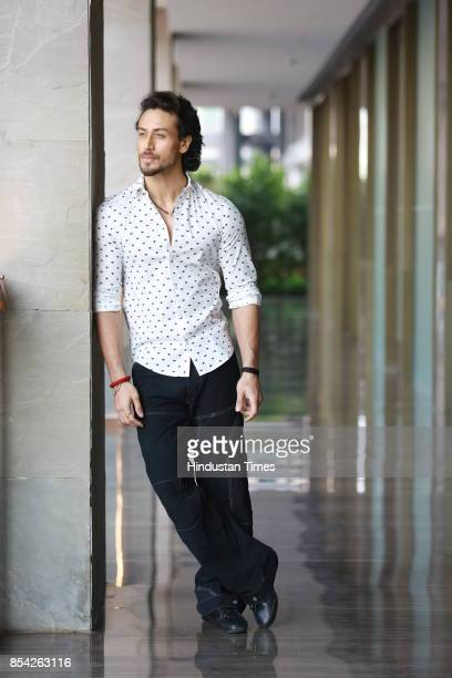 Bollywood actor Tiger Shroff poses for a profile shoot during the promotion of his upcoming movie 'Munna Michael' at Roseate House Hotel on July 18...