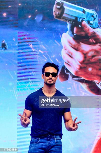 Bollywood actor Tiger Shroff poses for photographs during the promotion of action thriller Hindi film WAR in Mumbai on October 4 2019