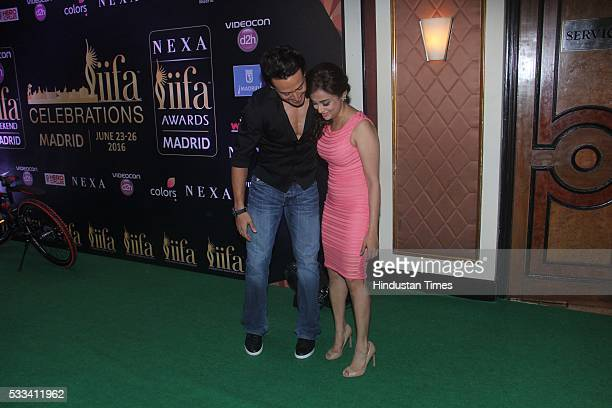 Bollywood actor Tiger Shroff with singer Monali Thakur during the press conference of 16th International Indian Film Academy Awards at Taj Lands End...