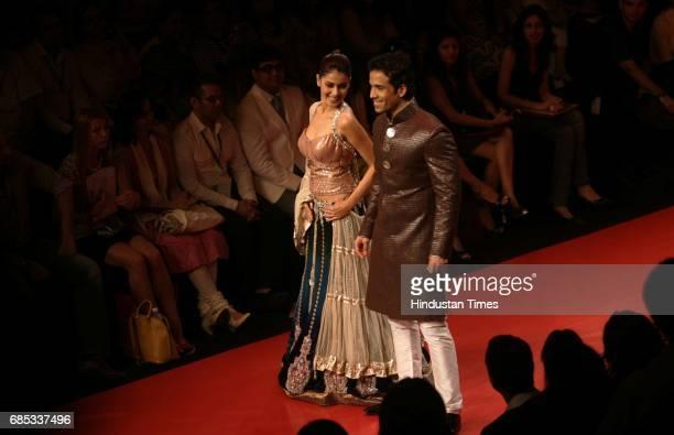LFW09 Bollywood Actor Tushar Kapoor and Actress Genelia D'souza walk on the ramp in a Manish Malhotra creation at Lakme Fashion Week at Grand Hyatt...