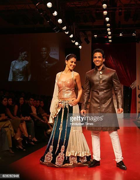 Bollywood Actor Tushar Kapoor and Actress Genelia D'souza walks on the ramp in a Manish Malhotra creation at Lakme Fashion Week at Grand Hyatt