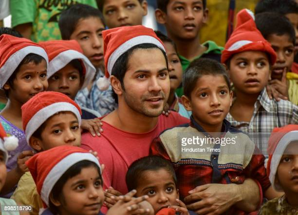 Bollywood actor Varun Dhawan celebrates preChristmas Day with kids in St Catherine of Siena School Orphanage at Bandra orphanage on December 17 2017...