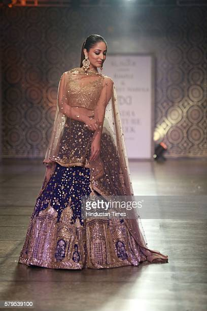 Bollywood actor Yami Gautam walks the ramp for the Indian fashion Designers Rimple Harpreet Narula on day 3 of FDCI India Couture Week 2016 at The...