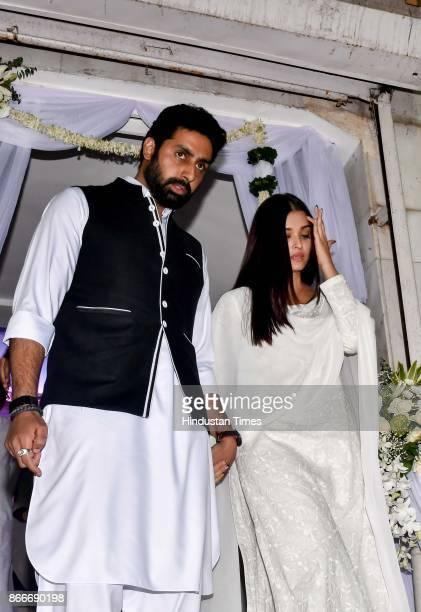 Bollywood actors Abhishek Bachchan and Aishwarya during the prayer meeting in loving memory of Ram Mukherjee at ISCON Juhu on October 25 2017 in...